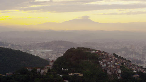 Still shot of the hills beneath a yellow sunset in Rio de Janeiro Footage