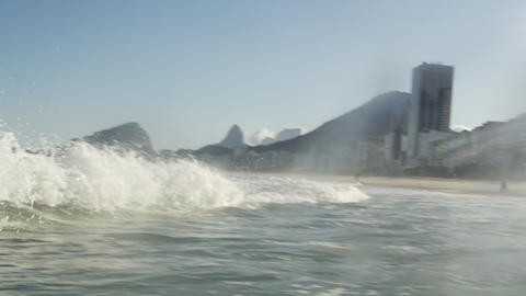 The waves of the Atlantic Ocean crashing into a beach in Rio de Janeiro Footage