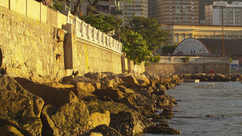 A static shot of a peaceful day along a rocky Rio de Janeiro shore Footage