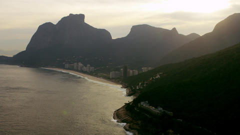 Aerial shot of shoreline and cliffs with golden light Footage
