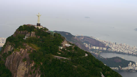 Aerial view of famous and reverent Corcovado mountain with back of Christ statue Footage