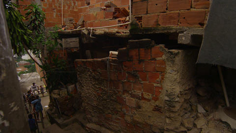 Slow motion dolly shot - turning a corner and going downstairs in a favela in Ri Footage
