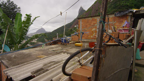 Slow tracking shot of messy area in a favela in Rio de Janeiro, Brazil Footage
