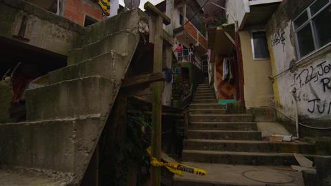 Slow motion panning/tracking shot inside favela neighborhood in Rio de Janeiro,  Footage