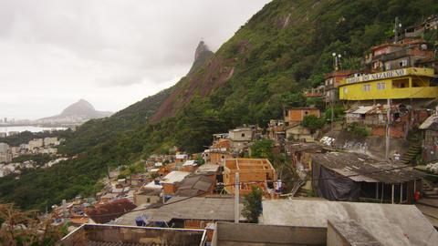 RIO DE JANEIRO, BRAZIL - JUNE 23: Slow panning shot overlooking favela of Rio sh Footage