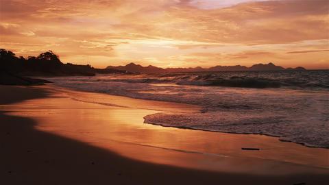 Slow motion tracking shot of huge waves crashing on Devil's beach (Praia do Diab Footage