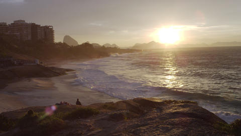 A lens flare hits the camera on a hiking path in Rio de Janeiro at sunset Footage