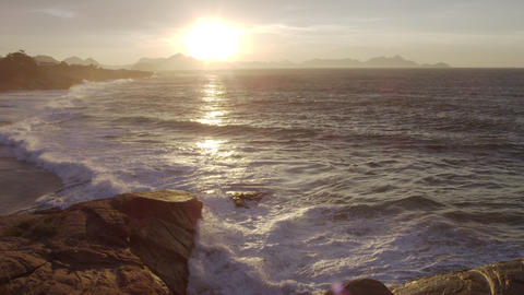 The sun rises over frothy waves at Ipanema Beach in Rio de Janeiro Footage