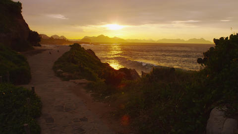 Sunset over a dirt path overlooking the beach in Rio de Janeiro Footage