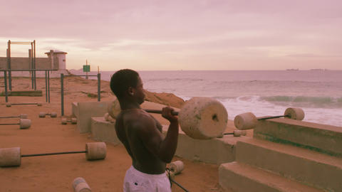 Weightlifting man does one rep at beach in Rio de Janeiro Footage