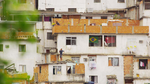 RIO DE JANEIRO, BRAZIL - JUNE 23: Static shot of people on rooftops in favela Ri Footage