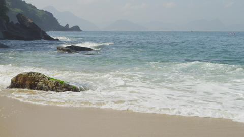 Slow motion of waves ebbing and flowing on the sand at Rio's Red Beach Footage