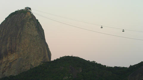 Static shot of a cable cars ascending and descending from Sugarloaf Mountain in  Footage