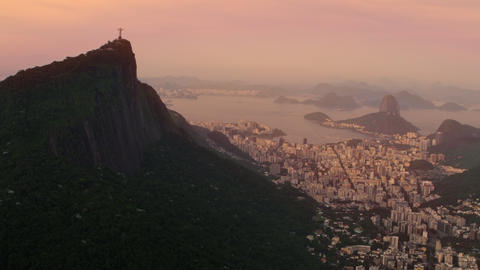 Helicopter shot of Christ the Redeemer and neighboring Rio de Janeiro neighborho Footage