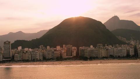 Aerial view of Rio de Janiero's coast centered on a mountain Footage