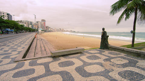 Slow tracking shot of a bronze statue near Ipanema Beach in rio de Janeiro, Braz Footage