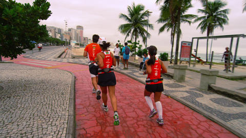 RIO DE JANEIRO, BRAZIL - JUNE 23: Slow dolly of runners on June 23, 2013 in Rio, Live Action