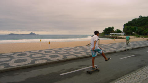 RIO DE JANEIRO, BRAZIL - JUNE 23: Slow dolly shot of skateboarders at Ipanema Ju Footage