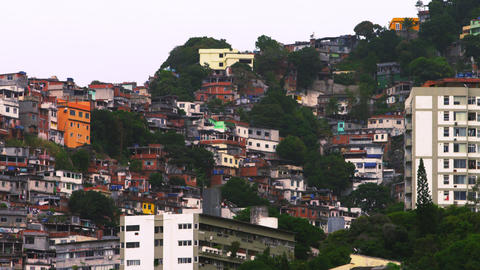 Panning shot of houses at a favela along the mountainside in Rio de Janeiro, Bra Footage