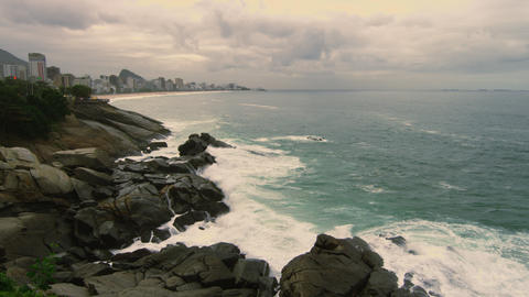 Slow motion shot of rocks and waves along the coastline of Rio de Janeiro, Brazi Footage