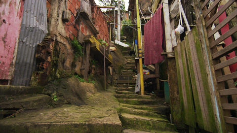 Tracking shot of shanties along the stairs in a favela in Rio de Janeiro, Brazil Footage