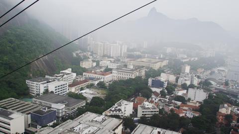 Tracking aerial shot of Rio de Janeiro, Brazil taken from a gondola Footage