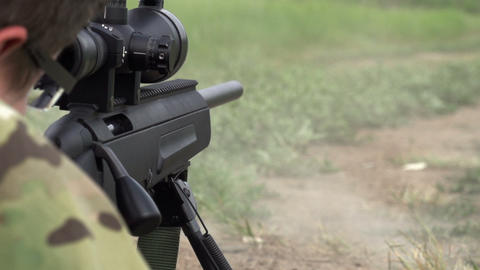 Sniper Shoots from a Rifle Footage