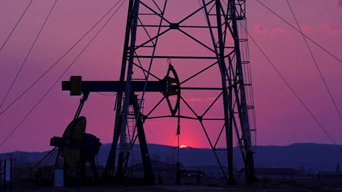 Oil Derrick mechanism in the sunset Footage