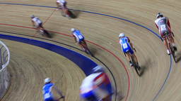 Cycling track race turn rear view Live Action