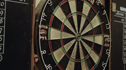 Throwing Darts into Dartboard HD stock footage Footage