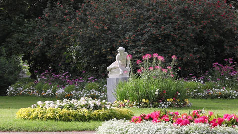 Sculpture Nymph Of Blooming Flowers stock footage