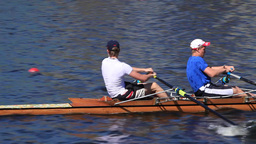 Sculling Two men rowing tracking shot Footage