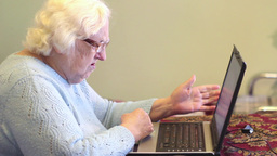 Old Woman And Computer Problems stock footage