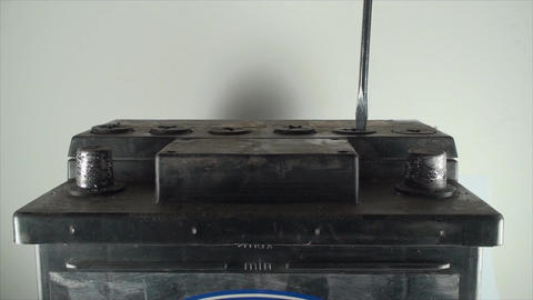 Opening Caps From A 12V Car Battery, Screwdriver,  Footage