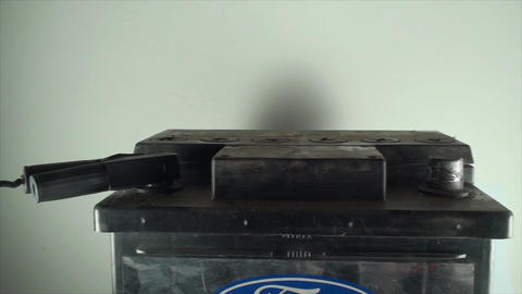 Man Hand Adding Plus To A 12V Car Battery, Isolate Footage