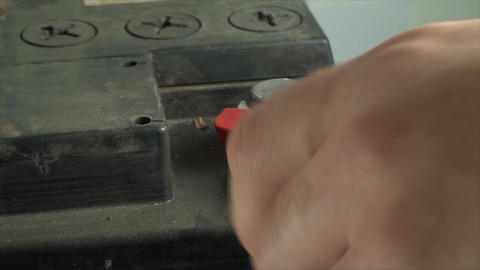 Man Hand Removing Plus From A 12V Car Battery, Iso Footage