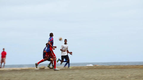Men Play Football On Fogo stock footage
