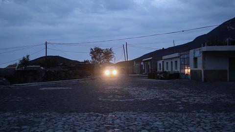 van driving on a cobblestone street on Fogo Footage