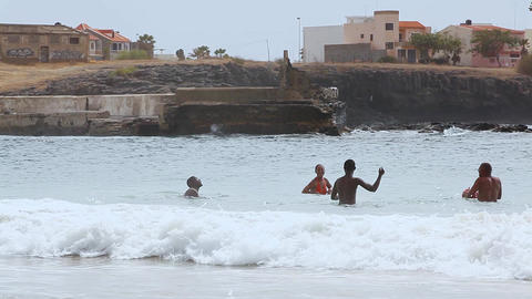 Young People Play Ball In The Waves At Tarrafal stock footage