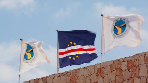 three flags blowing in the wind on Cape Verde Footage