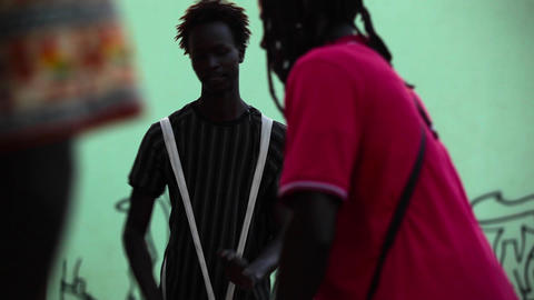 two African men playing drums in Boa Vista Footage