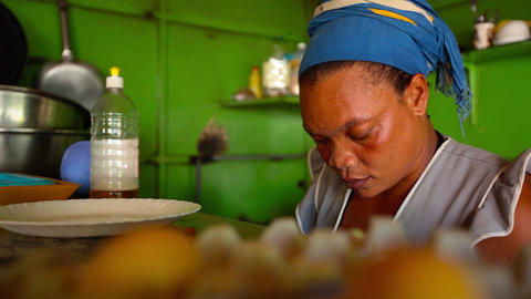 African Woman Working In A Kitchen In Santiago stock footage