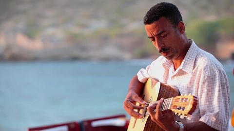 man plays the guitar at Tarrafal Footage