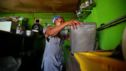 African woman working in a kitchen in Santiago Footage