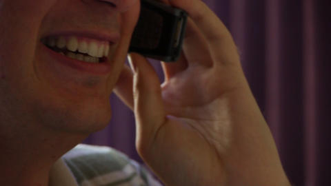 Man on the phone laughing Stock Video Footage