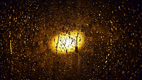 Raindrops at nighttime Footage
