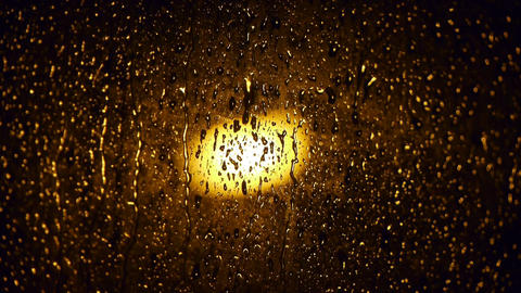 Raindrops at nighttime Stock Video Footage