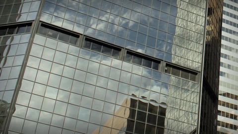 1184L City Skyscrapers Urban Buildings Architecture Windows Clouds Reflections Footage