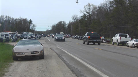 Bikers passing along road Stock Video Footage