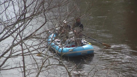 Boat with two men on river Stock Video Footage